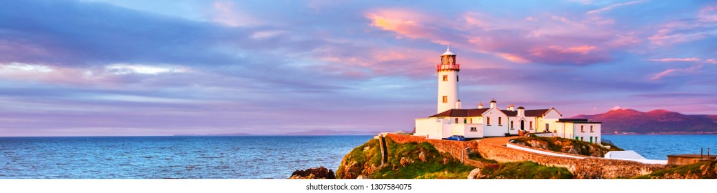 Donegal, Ireland. Fanad head at Donegal, Ireland with lighthouse at sunset. Colorful sky, mountains and sea