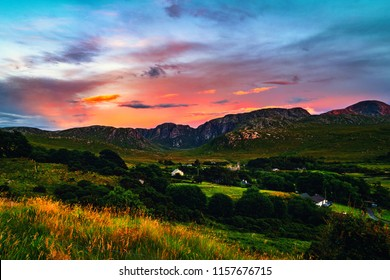 Donegal, Ireland. Landscape in Dunlewey with abandoned church in Donegal, Ireland. Colorful sunset sky. Green landscape in the evening