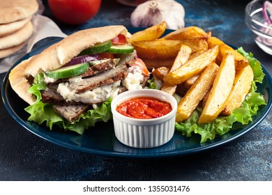 Doner kebab - fried minced meat in pita bread with french fries and ajvar