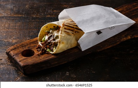 Doner Kebab Gyros Shawarma beef roll in pitta bread Wrap sandwich on wooden background