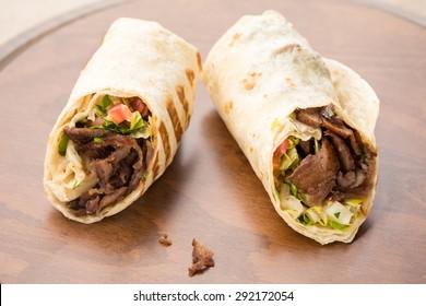 Doner kebab on wooden background. Natural light, horizontal