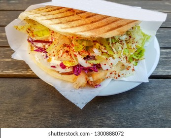doner kebab also döner served on a plate street food germany with various accompaniments stuffed into a pita flatbread on a table outdoor top view