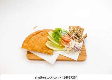 Doner Kebab set up top view on chopping board on white background