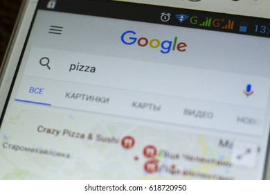 Donetsk, April 2017 - Generic smartphone screen close up with google search application. Macro shot of search query for pizza delivery. Abstract  internet services background.