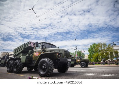 DONETSK, Donetsk People Republic. May 9: Soviet multiple rocket launcher BM-21 Grad (M1964) on the main street of the Donetsk city during Victory day Parade. 2016, May 9.