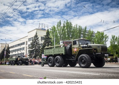 DONETSK, Donetsk People Republic. May 9: Soviet 120 mm mortar  towed by truck with the artillery crew on the main street of the Donetsk city during Victory Day Parade. 2016, May 9.