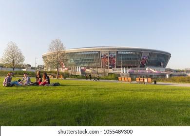 Donetsk, Ukraine - April 29, 2017: Citizens relax in the Park near the Donbass arena stadium
