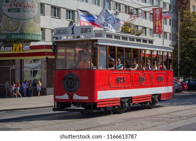 Donetsk, Ukraine - August 26, 2018: Townspeople riding a retro tram at the celebration of the City Day