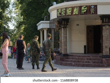 "Donetsk, Ukraine - August 26, 2018: Soldiers of the People's Militia of Donetsk and People's Republic at the cafe with the name ""Separatist"""