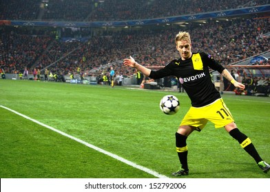 DONETSK, UKRAINE - DEC 5: Marco Reus with a ball in the Champions League match between Shakhtar vs Borussia Dortmund, 5 December 2013, Donbass-Arena, Donetsk, Ukraine