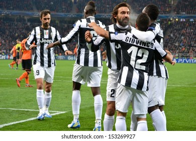 DONETSK, UKRAINE - DEC 5: Pirlo and Juventus football players celebrate scoring a goal in the Champions League match between Shakhtar vs Juventus, 5 December 2012, Donbass-Arena, Donetsk, Ukraine