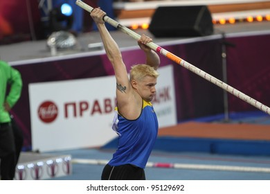 DONETSK, UKRAINE - FEB.11: Denys Yurchenko on the Samsung Pole Vault Stars meeting on February 11, 2012 in Donetsk, Ukraine. He won bronze medal in the pole vault event at Summer Olympics in Beijing.