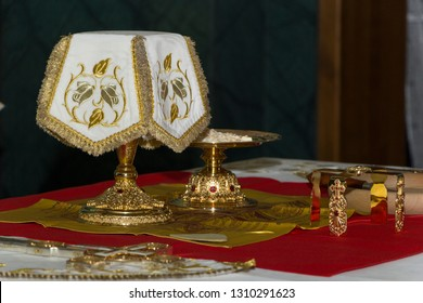 Donetsk, Ukraine - January 19, 2019 year. Trinity Cathedral. Holy Eucharist in orthodox church: Prepared for sanctification pieces of bread and wine in covered chalice on Holy See, during  liturgy.