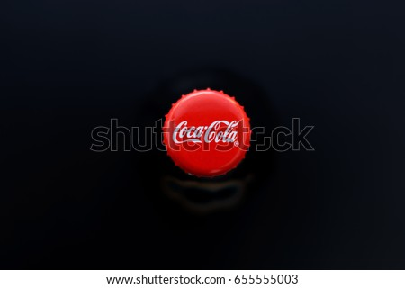 Donetsk, Ukraine - June 05, 2017. Coca Cola bottle. Top view. Low key and soft focus.
