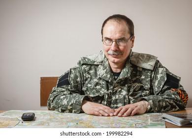 DONETSK, UKRAINE - JUNE 21: Portrait of Deputy Commander of the militia Fedor Berezin in the Donetsk Regional State Administration on background on june 21, 2014 in Donetsk.