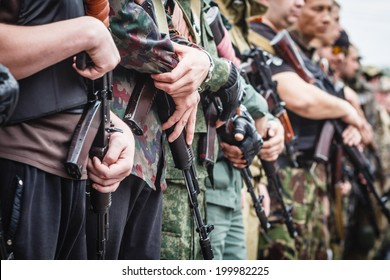DONETSK, UKRAINE - JUNE 21: Weapons in hands of fighters, who taking the oath during ceremony on june 21, 2014 in Donetsk.