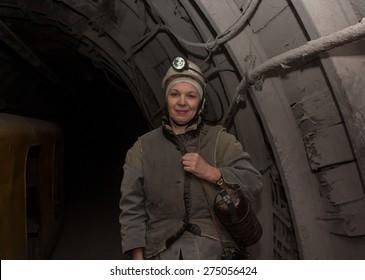 Donetsk, Ukraine - March, 14, 2014: Woman surveyor in the underground mine. Mine is named Abakumov