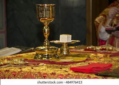 Donetsk, Ukraine - May 1, 2016: Holy Eucharist in orthodox church: Consecrated bread and wine in chalice on Holy See, during orthodox liturgy on Easter. Trinity Cathedral in Donetsk, Ukraine.