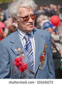 DONETSK, UKRAINE - MAY 9: Unidentified veterans at Victory Monument during the celebration of Victory Day on May 9, 2011 in Donetsk, Ukraine.