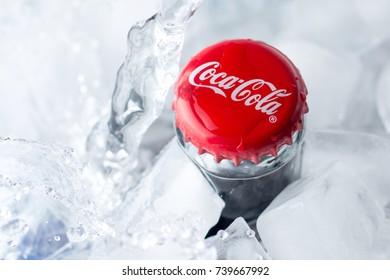 Donetsk, Ukraine - October 08, 2017. Coca Cola bottle in ice. Close up with soft focus.