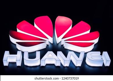 Dongguan, China - 11-26-2017: Logo of Huawei at night on the main building of Huawei Base in Songshan Lake District of Dongguan city, Guangdong Province, China.