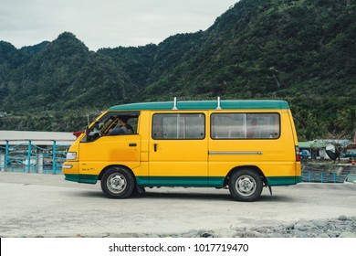 DONGHE, TAITUNG / TAIWAN - January 23 2018:  A yellow vintage bongo van with a green roof near Jinzun beach in Donghe, Taitung, Taiwan on January 23.