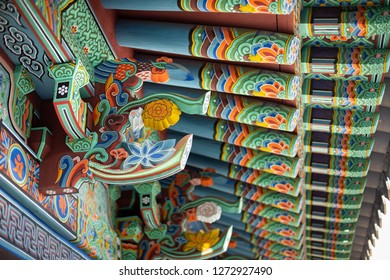 Donghwasa, Daegu / South Korea - October 8 2018: Side view on a wood bird carving with colorful Dancheong painting, on the exterior of the Donghwasa Buddhist Temple, with space for text on the right