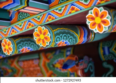 Donghwasa, Daegu / South Korea - October 8 2018: Close up on the colorful Korean Dancheong painting, on the exterior of the wooden Donghwasa Buddhist Temple