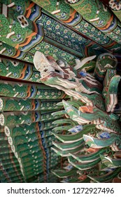 Donghwasa, Daegu / South Korea - October 8 2018: Wood dragon carving with colorful Dancheong painting, on the exterior of the Donghwasa Buddhist Temple