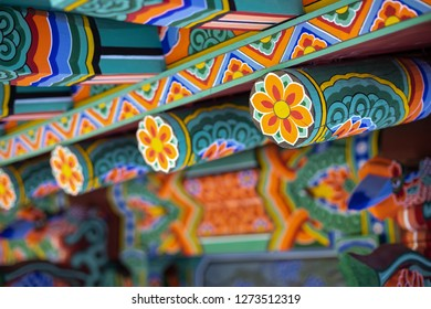 Donghwasa, Daegu / South Korea - October 8 2018: Colorful Korean Dancheong painting, on the exterior of the wooden Donghwasa Buddhist Temple
