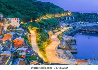 Dongyong Harbor and The Small Village on the Hill At Nightfall in Dongyin, Matsu, Taiwan