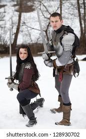 "DONJA STUBICA, CROATIA - FEBRUARY 9: Representation of the Croatian-Slovenian peasant revolt ""Seljacka buna"" of 1573, on February 9, 2013 in Donja Stubica, Croatia. Knight and lady posing with a sword"