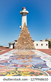 Donkin reserve in Port Elizabeth south Africa showing mosiac tiles in the foreground and lighthouse in the background