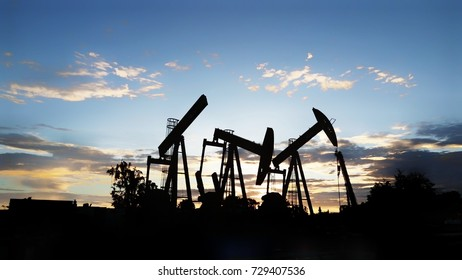 Donky pump or beam pump choke up the oil from the deep hold, Production the energy for the world, Business energy
