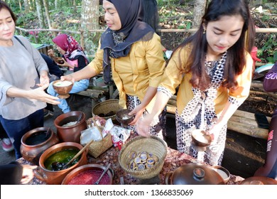 Donorejo, Magelang, Indonesia - March 31, 2019: Traditional markets that are open every Sunday, with sellers wearing Javanese clothes, who sell local food