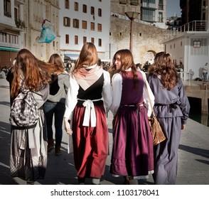DONOSTI, SPAIN-DECEMBER 21, 2014: Group of girls dressed in typical costume in Donosti celebrating Santo Tomas day on December 21, 2014