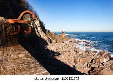 DONOSTI, SPAIN-DECEMBER 22, 2014: On sunny days,in the end of the la Concha beach you can see Chillida's sculptures in Donosti on December 22, 2014