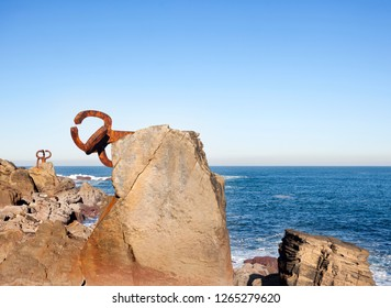 DONOSTI, SPAIN-DECEMBER 22, 2014: On sunny days,in the end of the la Concha beach you can see Chillida's sculptures in Donosti, Spain on December 22, 2014