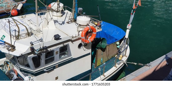 Donostia San Sebastian, Basque Country, Spain, July, 4, 2020: inshore fishing boat with different fishing gear in the port of Donostia in the Basque country