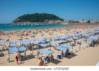 Donostia, Spain - august 02, 2018: Panoramic view of La Concha beach in the coastal city of San Sebastian, a sunny day