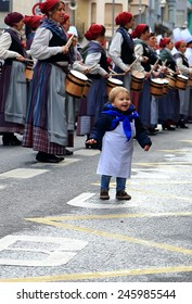 DONOSTIA, SPAIN - JANUARY 20: Local little girl in traditional dress participate in the parade of her city.s holiday on January 20, 2015 in San Sebastian-Spain.