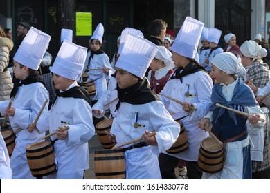 DONOSTIA, SPAIN - JANUARY 20: Undefined school children in traditional dress participate in infantile Tamborrada parade on January 20, 2017 in Donostia-San Sebastian, Spain