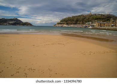 DONOSTIA-SAN SEBASTIAN, SPAIN - MARCH 6  2019: One of the most famous city beaches in Europe, the Playa de La Concha.