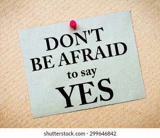 Don't Be Afraid To Say YES Message written on recycled paper note pinned on cork board. Motivational concept Image