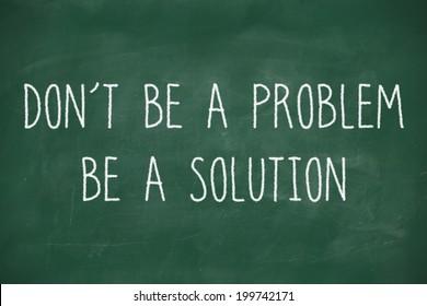Dont be a problem handwritten on school blackboard