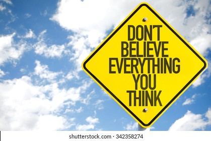 Don't Believe Everything You Think sign with sky background