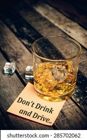 Don't Drink and Drive with label on paper note. Glass of scotch whiskey