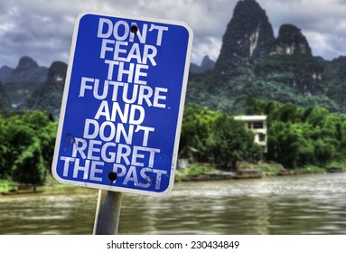 Don't Fear The Future and Don't Regret The Past sign with a forest background