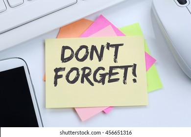 Don't forget date meeting remind reminder notepaper business concept desk computer keyboard