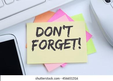 Don't forget date meeting remind reminder notepaper business concept desk computer keyboard